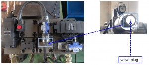 Check valve plug on hydraulic baler